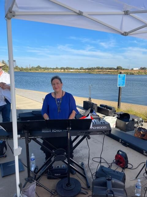 A band playing on the lake docks for the community at Michael Vega Park in River Islands