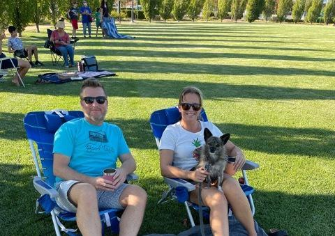 Families relaxing with their friends and dogs at Michael Vega Park in River Islands