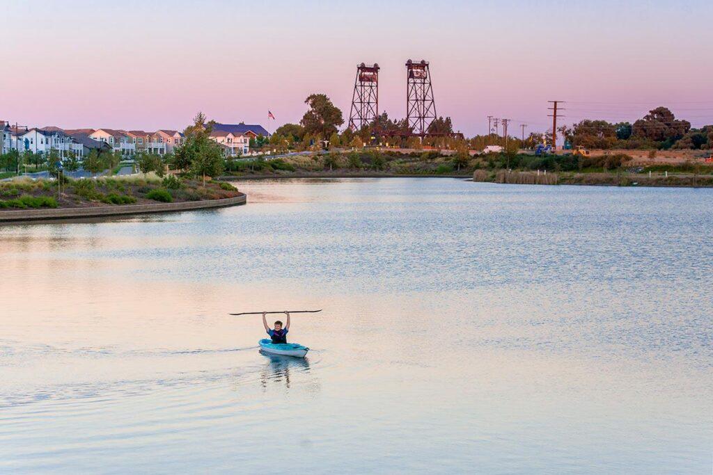 man kayaking on lake at river islands